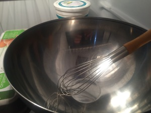 Put a large stainless steel bowl and a whisk in the fridge
