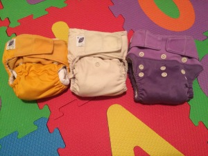 GroVia diapers with the snaps adjusted to fit (from left to right) 0-3 months, 4-6 months, 6-12 months. They can adjust even more to fit up to 35 lbs.